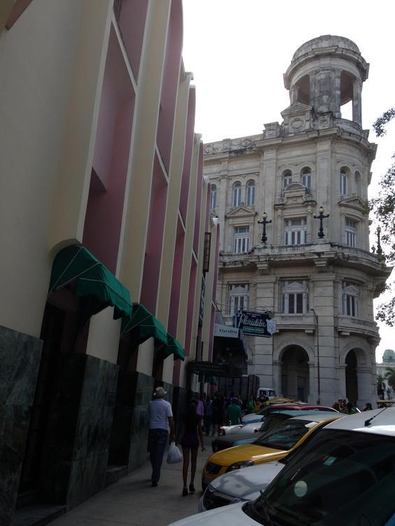 Contrast between old and new architecture in Cuba.