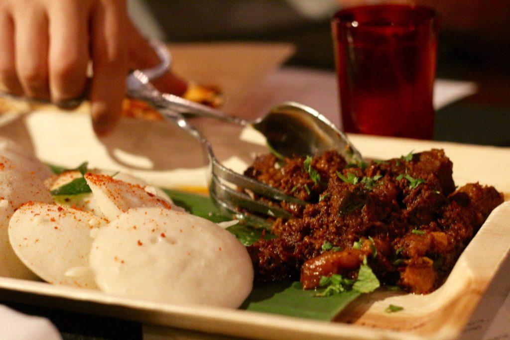 goan-chujang pork vindaloo, idli  (fermented & steamed rice&urad dal cakes) by chef Meherwan Irani & James Grogan of Chai Pani