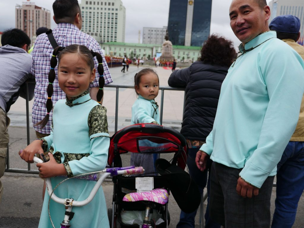 Family at a parade in UB/ Photo by Amanda Villa-Lobos
